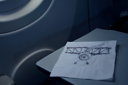 flight concept, airman funny sketched on a paper napkin on the plane table