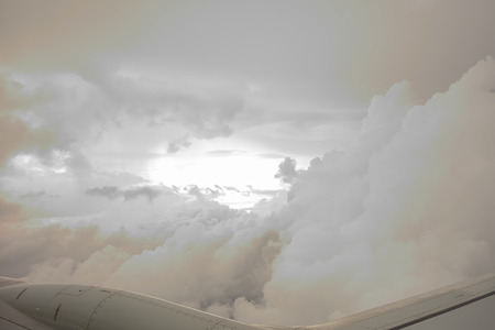 view of the clouds from the window of an airplane