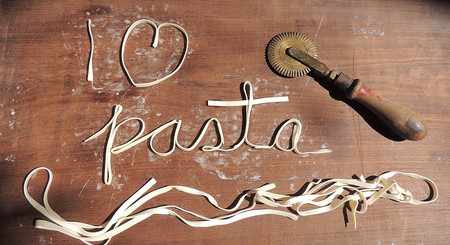 I love paste text made with fresh spaghetti on a wood table Stock Photo