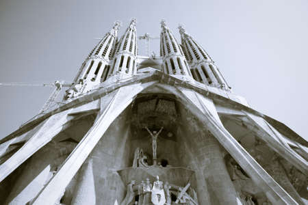 The facade of the Sagrada Familia church in Barcelona, Spain - monochrome