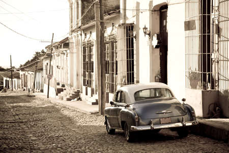 An old american car in the colonial streets of Trinidad in Cuba photo