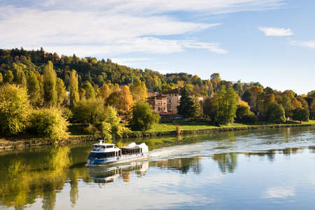 forest river: The river Po and surrounding park in autumn seen from the Umberto I bridge in Torino, Italy
