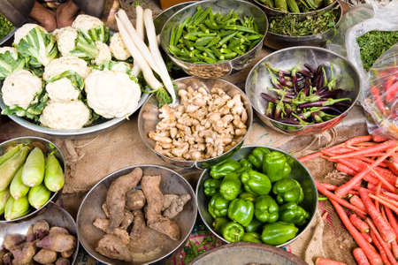 asian food: A display of vegetables in a stand in a vegetable market in Jodhpur, India