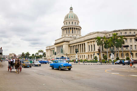 paseo: Havana, Cuba - November 28, 2012 : Traffic in front of the Capitolio building on the Paseo de Marti street on a cloudy day