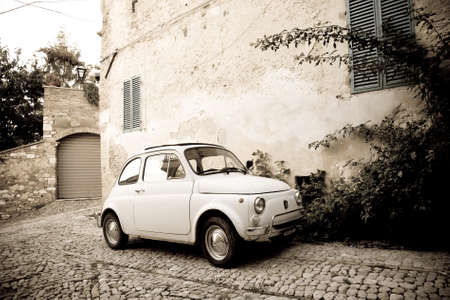 spello: Spello, Italy : 2014, October 4 : A vintage Fiat 500 known as the Cinquecento in a cobbled street of the town of Spello in Umbria