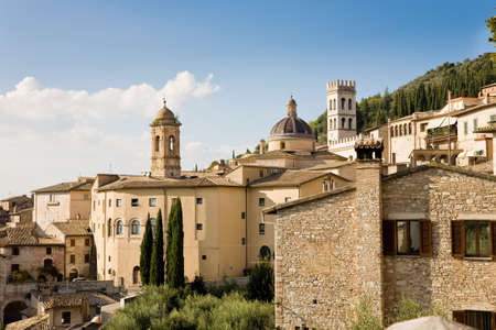 assisi: A cityscape of Assisi with new church and city hall, Italy