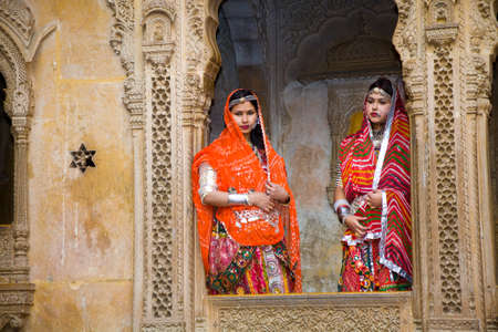 Jaisalmer, India - 2015, January 7 : Two female Indian tourists dressed up in traditional clothing and posing for a photograph in the Patwon Ki Haveli in Jaisalmer, Rajasthan Editorial