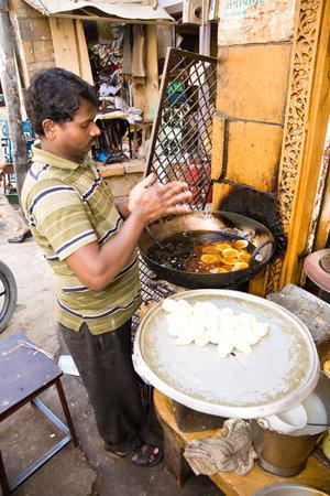 jaisalmer: Jaisalmer, India - 2015, January 7 : A vendor preparing snacks made of fried dough in a stall on the street