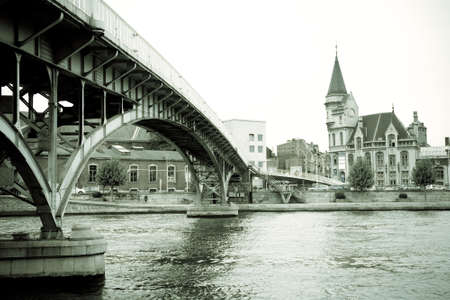 meuse: The Saucy footbridge over the river Meuse and the historic former post office in the Belgian town of Liege in the Wallonia region of Belgium
