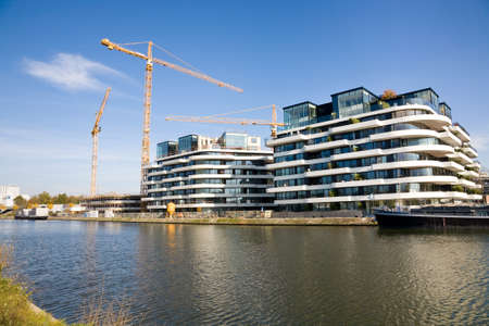 limburg: Hasselt, Belgium - 2015, October 26 : Construction site of new flats on the quayside of the harbour of Hasselt on the Albert Canal in the Limburg province of Belgium