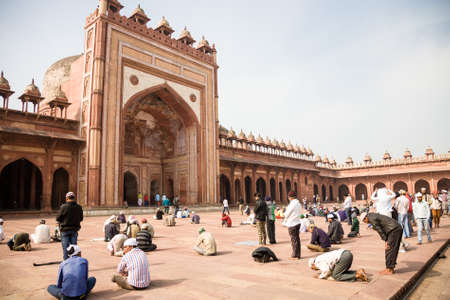 Fatehpur Sikri, India - 2015, January 9 : The courtyard of the very important mosque Jama Masjid in Fatehpur Sikri with worshippers praying outside