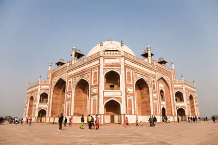 mughal: Delhi, India - 2014, December 27 : The tomb of Humayun, a famous Mughal landmark and tourist destination in Delhi, with visitors walking in front of the mausoleum Editorial