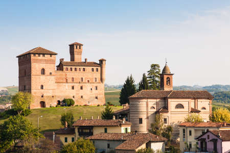 cavour: Grinzane Cavour, Italy - 2016, September 27 : The village of Grinzane Cavour in the Piemonte region of Italy with its castle in the background Editorial
