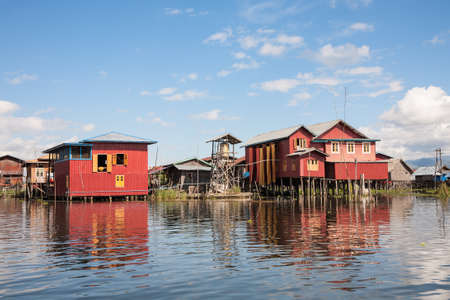 A village with houses on piles on the shores of the Inle Lake in the Shan state in central Burma Stock Photo