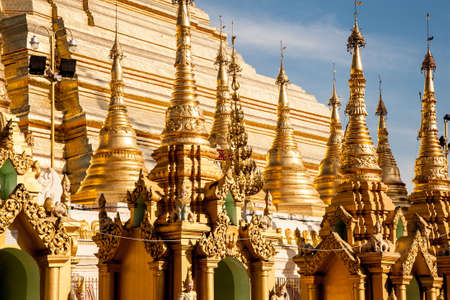 A detail of the golden stupa of the buddhist Shwedagon Paya, the most famous landmark of the city of Yangon in Burma