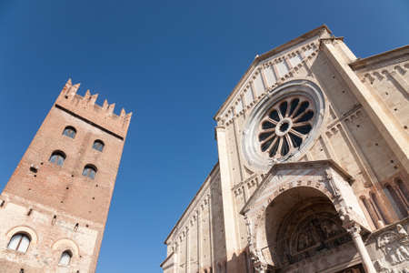 The facade of the San Zeno cathedral and the tower of the monastery, Verona, Italy Stock Photo