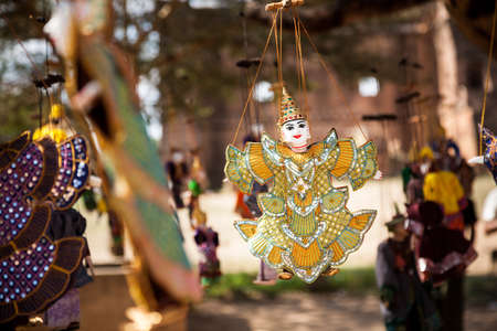 A Burmese string puppet hanging on a set of strings in the town of Bagan in central Myanmar