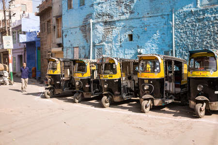 Jodhpur, India - 2015, January 4 : Five auto rickshaw taxi or tuk-tuk in a parking in the streets of the historic center of the blue city of Jodhpur, Rajasthan