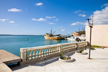 The harbour of Cienfuegos with some old rusty boats, Cuba Stock Photo - 91172527
