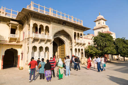Jaipur, India - 2014, December 29 : A number of tourists standing in front of the Rajendra Pol which is a decorated gateway in Jaipurs City Palace complex