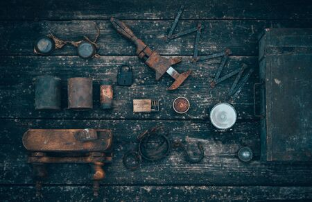 postwar: Old and rusty tools on a old board background. Flat lay and top view Stock Photo