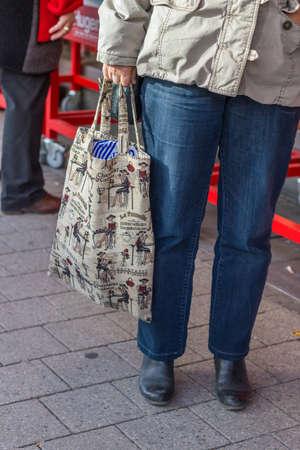 reusable: Woman with pretty reusable shopping bag on the street