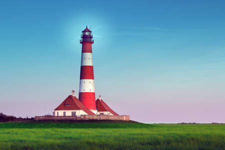 schleswig holstein: Old light house in Westerhever,Germany at Blue Hour at summer afternoon