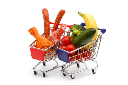 Two shopping carts, one is full with meat and one with vegetables, stand side by side photo