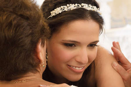 beautiful marriage: Bride is congratulated and embraced by her mother  Stock Photo