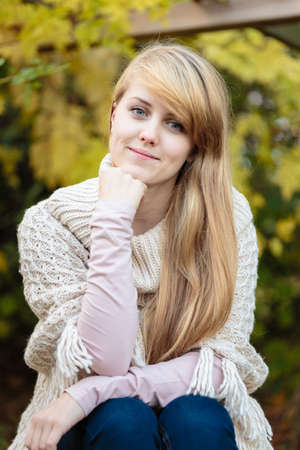 Pretty young woman,late teen girl,with very long blond hair,outdoor candid portrait