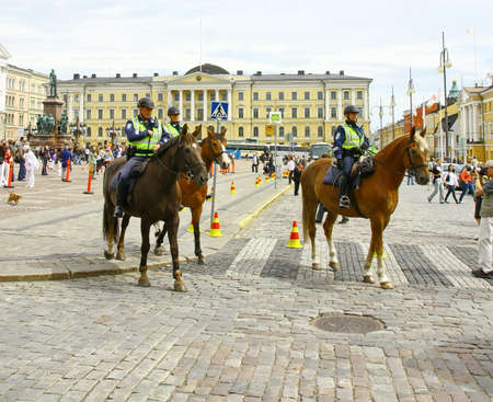 HELSINKI, FINLAND - JUNE 30: Mounted police protect people taking part in the annual Helsinki Pride gay parade in Helsinki, Finland on June 30, 2012.  Stock Photo - 17436284
