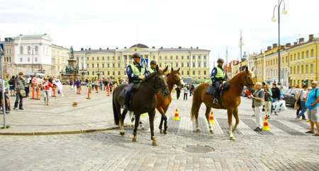 HELSINKI, FINLAND - JUNE 30: Mounted police protect people taking part in the annual Helsinki Pride gay parade in Helsinki, Finland on June 30, 2012.  Stock Photo - 17436052