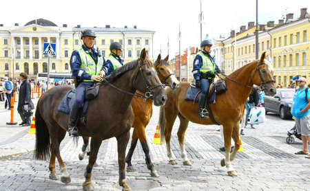 HELSINKI, FINLAND - JUNE 30: Mounted police protect people taking part in the annual Helsinki Pride gay parade in Helsinki, Finland on June 30, 2012.  Stock Photo - 17436330