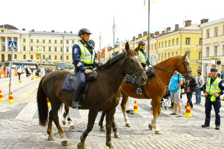 HELSINKI, FINLAND - JUNE 30: Mounted police protect people taking part in the annual Helsinki Pride gay parade in Helsinki, Finland on June 30, 2012.  Stock Photo - 17436319