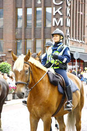 HELSINKI, FINLAND - JUNE 30: Mounted police protect people taking part in the annual Helsinki Pride gay parade in Helsinki, Finland on June 30, 2012.  Stock Photo - 17436343
