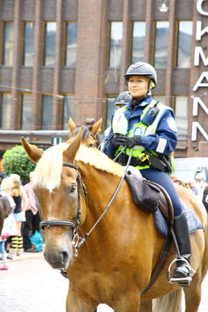 HELSINKI, FINLAND - JUNE 30: Mounted police protect people taking part in the annual Helsinki Pride gay parade in Helsinki, Finland on June 30, 2012.  Stock Photo - 17436310