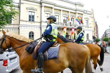 HELSINKI, FINLAND - JUNE 30: Mounted police protect people taking part in the annual Helsinki Pride gay parade in Helsinki, Finland on June 30, 2012.  Stock Photo - 17436418