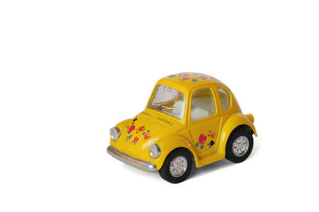 Yellow little toy car, for games photo