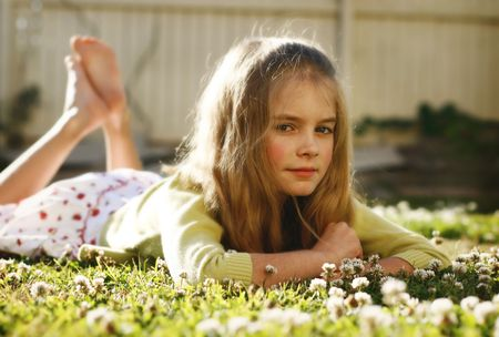 Cute girl lying on grass