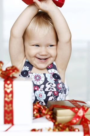 Little girl opening presents photo