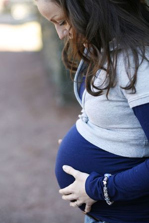 Young pregnant woman outdoors. Stock Photo