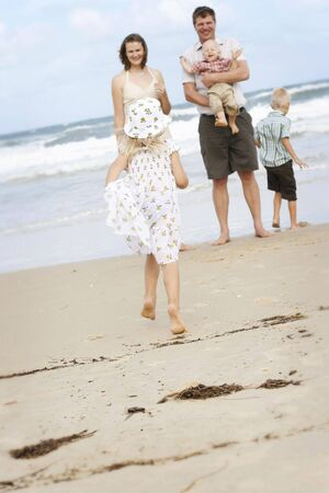 Family spending time together at the beach. Stock Photo - 4908833