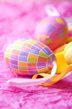 Bright coloured Easter eggs on pink  Stock Photo