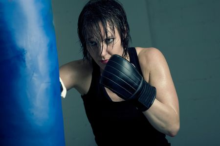 female boxer: Strong, beautiful female boxer having a workout