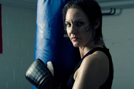 Strong, beautiful female boxer having a workout photo