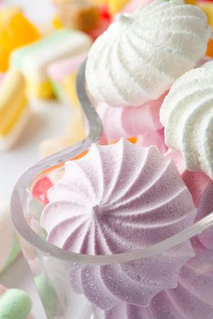 A close-up of multi-colored candies and meringues photo