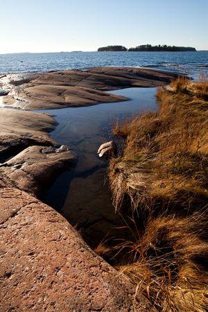 Rocky seashore in Helsinki, Finland. Beautiful autumn day. photo