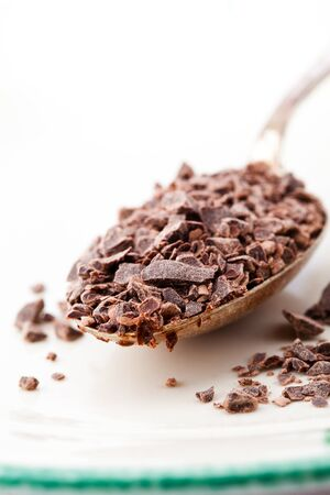 Close-up on chocolate chips on a table spoon Stock Photo