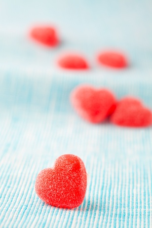 Heart shape candy for Valentines day on a light blue background