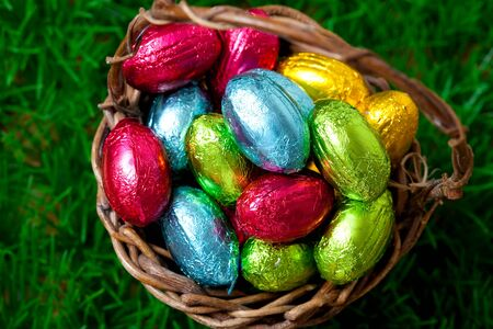 Close-up of colorful Easter eggs in a basket. photo